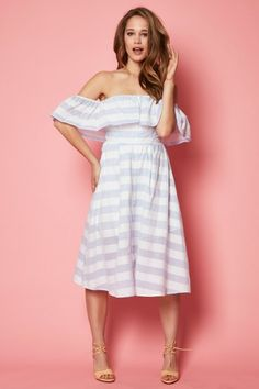 Off the shoulder blue and white stripe printed dress with a short top overlay. Features a button front closure and short lining. Please note dress will ship April 15th.