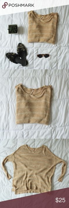 Free People Striped Sweater Super cute sweater from Free People with beige and cream stripes.  Tag says size small, but can also fit medium.  In great condition other than a small hole on the back, shown in the last picture. Free People Sweaters