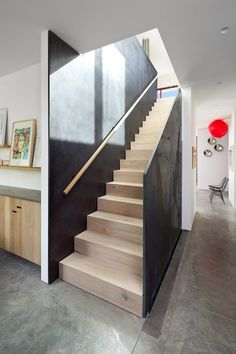 Inside Rough House by Measured Architecture, the team created a central stair with walls made of hot-rolled steel.