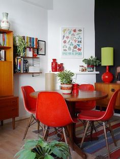 Add a festive note to your dining room for the coming Holidays season! As a true accent piece in the dining room or your kitchen, a set of red dining chairs is sure to compliment any decor. Dining Room Design, Dining Area, Dining Table, Red Dining Chairs, Red Dining Rooms, Eames Chairs, White Chairs, Lounge Chairs, Upholstered Chairs