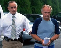 The Rev. Arthur Burton Schirmer, 62, right, is led into district court -- is accused of killing his wife and staging a car accident in July 2008 to cover up the murder.