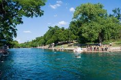 Austin, TX: BARTON SPRINGS  This popular recreational outdoor swimming pool is filled entirely with water from nearby natural springs. If the weather is nice, people will be there, except on Thursdays when the pool is closed until 7 p.m. With an average temperature of 68-70 degrees, it is ideal for year-round swimming. The Springs serves as home to the endangered Barton Springs salamander, and is listed as a federally protected habitat.