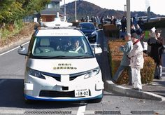 Japan's first test of a remote-controlled driverless vehicle on a public road is held in Aichi Prefecture, home to Toyota and other auto companies.