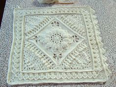Charlotte is a large crochet square. Dense overlay stitches combine with more lacy parts to create a delicate, vintage feel.