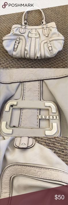 Guess off-white shoulder bag. Inside pockets. Guess shoulder bag. Off white. Inside zippered compartment and card slots. Flowered lining. Straps are in great shape. The bag itself is in really good condition. G signature lines this bag on the outside. Guess Bags Shoulder Bags