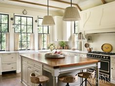 Cottage kitchen, wood topped island, wood trim, marble, cafe curtains, light and bright...