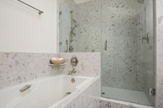 Contemporary Master Bathroom with Frameless Shower Doors By Dulles Glass and Mirror, High ceiling, Handheld Shower Head