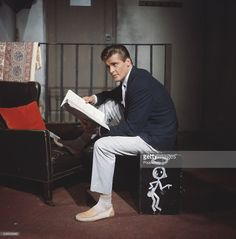 English actor Roger Moore, who plays Simon Templar in the television series 'The Saint', pictured holding a script for The Pearls Of Peace episode at Elstree Studios in England in Get premium, high resolution news photos at Getty Images Roger Moore, The Saint Tv Series, Eric Rogers, Script, Templer, Tony Curtis, Best Horror Movies, Best Horrors, Great Tv Shows