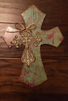 A personal favorite from my Etsy shop https://www.etsy.com/listing/473000128/9-x-12-teal-and-rust-wooden-cross