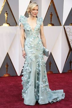 This dress was one of my favorites - the color, the sweep, and the appliques.  Simple, yet textured.  This is it: the red carpet to end all red carpets (until the Tonys, that is).