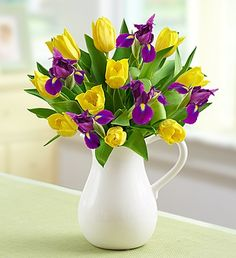 This Pitcher Full of Spring bouquet featuring blooming yellow tulips and vibrant purple iris arranged in a reusable ceramic pitcher is a sure way to tell when spring has sprung.
