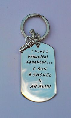 Hand stamped keyring 'I have a beautiful daughter..a gun, a shovel and an alibi' £12.50