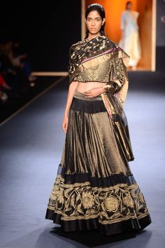 Black and gold hand embroidered lehenga set by Rahul Mishra. Shop now: http://www.perniaspopupshop.com/designers/rahul-mishra #shopnow #perniaspopupshop #rahulmishra #aicw #aicw2015