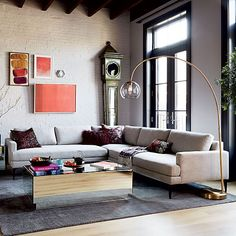 Living Room With Ikea Karlstad Sofa And Eames Lounge Chair