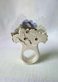 "Ring by Wile'e Malia. ""Genetic Dichotomy: Seeking Light"". Silver, brass, plexiglass, dispersed dyes http://www.ganoksin.com/"