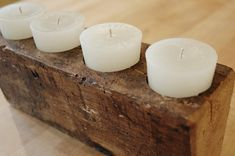 This is a fabulous reclaimed barn wood candle holder with four holes for tapered pillar candles. The wood was upcycled from a wooden beam and