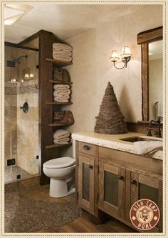 Warm, modern rustic bathroom...this is just what I want--a walk in shower with shelves or linen closet in the corner--love the off-set shelves!