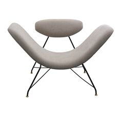 Chair by Martin Eisler (1913-1977).  He and Carlo Hauner (1927-1997) were the primary designers for the iconic Brazilian furniture company Forma.  Their exceptional furniture exemplifies  the modern movement in South America.  Eisler was born in Austria and studied architecture there.  He moved to Buenos Aires in 1938  Hauner studied design in Milan, and immigrated to Brazil after World War II.