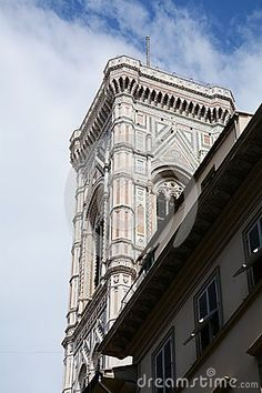 Florence cathedral, Duomo and a part of the tower against the blue sky, Florence, Italy