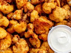 Tender florets of cauliflower in a crispy, lightly spiced coating. Served with our creamy vegan garlic aioli. Cauliflower Fritters, Garlic Aioli, Vegan Comfort Food, Vegan Restaurants, Plant Based Recipes, Whole Food Recipes, Spices, Eat, Ethnic Recipes