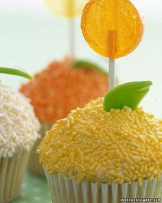 Celebrate spring with blooming lollipops atop your birthday treats. Mound vanilla icing high, and cover in sprinkles. Snip leaves from taffy tape.
