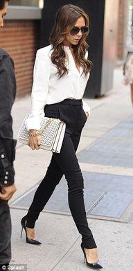 Shoes - Manolo Blahnik Pants, shirt, and handbag - Victoria Beckham collection.