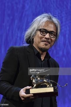 Director Lav Diaz receives the Golden Lion award for Best Film for the movie…