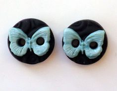 Handmade polymer clay buttons with black textured background and soft pastel yellow butterflies. Sew these butterflies to your hand knit, crochet