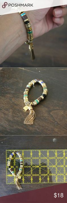 Jenny Bird Multi Mantra Tibetove Bracelet Comfortable and easy with luxurious boho tassel, the Tibetove is a great addition to your daily stack. Wood and hand carved in the Philippines with natural dyes and gold plated. Jenny Bird Jewelry Bracelets