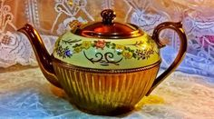 Gibson teapot in bronze lustre with hand decorated floral details