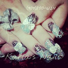 these are dope glittery animal print an bow nails.. thats all my fave if only they were pink haha :) <3