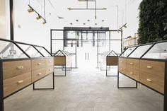 Serra, a Store for the Cannabis Cannaseur - Design Milk ; [[Muted geometric stone   black   brass]]