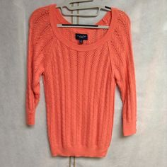 American eagle coral sweater large Has been worn maybe 3 times, soft and comfy, has buttons on the end of he sleeve (no missing buttons) no flaws, no trades, I would say this is more on the coral pink side than the coral orange American Eagle Outfitters Sweaters Crew & Scoop Necks