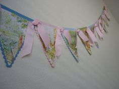 Peter rabbit bunting - using old peter rabbit books.Beatrix potter baby shower idea