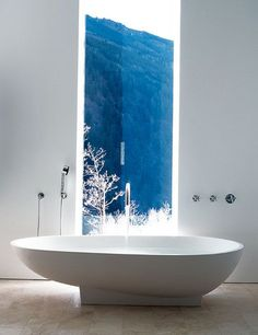 Simple but classic looking white bathtub. Spruce up your bathtub by incorporating artistic designs on the walls such as forest or waterfalls cascading the waters down into the tub for effect.