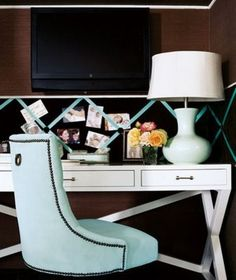 Home office. Blue velvet chair.  Display board has matching ribbon.  Trestle desk in white.  Sweet.