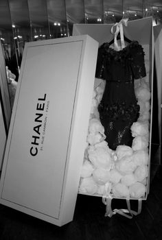 haute couture Chanel I like the idea of the garment coming in a large branded box. It is very unusual and with all Chanel packaging it is kept plain and simple.