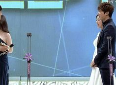 This is a gif of Kim Woo Bin presenting the best couple award to Park Shin Hye and Lee Min Ho.