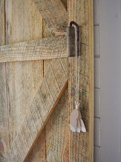 DIY sliding barn door in our latest nursery reveal!