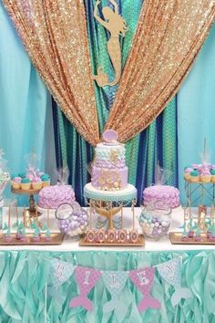 Make a splash with a mermaid baby shower. It's the right choice for a mommy-to-be who loves everything ocean and there's so much to choose from to decorate it with, such as mermaids, starfish, and shells, etc... The most popular color schemes are turquoise, pink, and purple, so if you love these colors, then this has to be the theme choice for you. See more parties ideas and share yours at CatchMyParty.com Baby Girl Shower Themes, Baby Shower Decorations For Boys, Baby Shower Princess, Shower Party, Baby Shower Parties, Shower Games, Little Mermaid Baby, Mermaid Baby Showers, Baby Shower Mermaid Theme