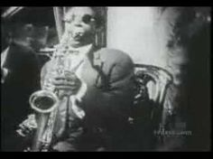 """"""" Agachado bajo el frío viento lluvioso yo lo observaba todo entre los tristes viñedos de octubre. Mi mente estaba invadida por esa gran canción de Billie Holiday Lover Man; tuve mi propio concierto entre las vides.  http://negraisla.wordpress.com/2011/10/16/sonidos-en-el-papel-vi-jack-kerouac/"""