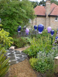 garden party lush green grass balloons purple lilac