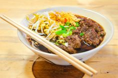 Close up of a bowl of Chinese style beef noodle soup by Constantin Stanciu on 500px