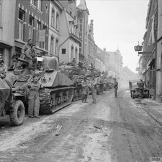 Sherman tanks of Armoured Brigade in Kevelaer, 4 March Then image: Imperial War Museum Catalogue number: B 15146 Creator: No 5 Army Film & Photographic Unit, Hutchinson (Sgt) Now imag… Ww2 Pictures, Ww2 Photos, Canadian Army, British Army, British Tanks, Cromwell Tank, Sherman Tank, Afghanistan War, Ww2 Tanks