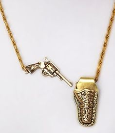 Annie get your gun! This antique-look necklace gets inspiration from the wild wild West with a brass gun holster and mini pistol on a delicate chain. Closing the necklace is easy; just tuck the gun in the holster for a secure fit! Cute Jewelry, Jewelry Box, Jewelry Accessories, Fashion Accessories, Unique Jewelry, Jewlery, Steampunk Accessoires, Schmuck Design, Diamond Are A Girls Best Friend