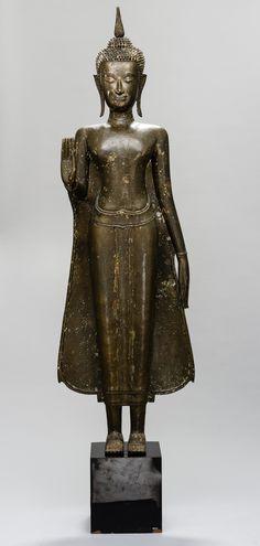 A BRONZE SCULPTURE OF A STANDING BUDDHA SHAKYAMUNI IN ABHAYA MUDRA   Gallery Zacke