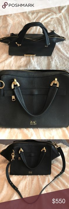 ZAC by Zac Posen black bag. Length: 13 1/2 inches. Height: 10 inches. Depth: 7 1/2 inches. Adjustable strap: 35 inches. It is authentic. Used with love. Not a fake. Leather bag. Top zip closure. Optional adjustable strap. Exterior zip pocket. Interior zip pocket. Interior wall & cell phone pockets. Protective metal feet. ZAC by Zac Posen. Zac Posen Bags Shoulder Bags