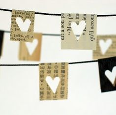 little paper hearts //yarn or some other type thin cord. Cut pieces from book/newspaper and fold over yarn/cord. Punch hearts into paper. This would be great as a garland for Valentine's day. Use other style punches for other holidays. Paper Heart Garland, Flag Garland, Pom Pom Garland, Paper Bunting, Diy Garland, Garland Ideas, Paper Garlands, Mini Bunting, Garland Wedding