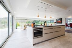 This couple wanted to create a warm and homely open-plan kitchen living space taking full advantage of the panoramic views that flank their home.