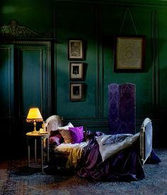 Beautiful dark dramatic bedroom in rich shades of purple, gold and green blue